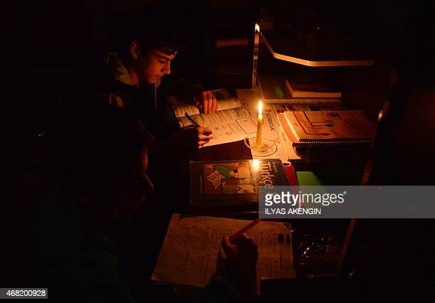 A student works in a dark room on March 31 in Diyarbakir A massive power cut caused chaos Tuesday in large parts of Turkey shutting down the metro...
