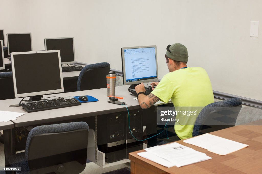 A student works on a computer in the Resource Learning Center at Penn Commercial Business/Technical School in Washington, Pennsylvania, U.S., on Tuesday, Aug. 15, 2017. While fracking has created a bonanza of jobs, displaced coal miners and their communities are sometimes left out of the boom. Thats because many of the jobs require highly technical skills and are often going to experienced workers brought in from out of state who then move on to the next job without sinking roots. Photographer: Stephanie Strasburg/Bloomberg via Getty Images