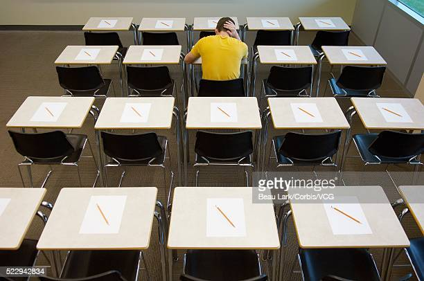 student writing exam - bad student stock pictures, royalty-free photos & images