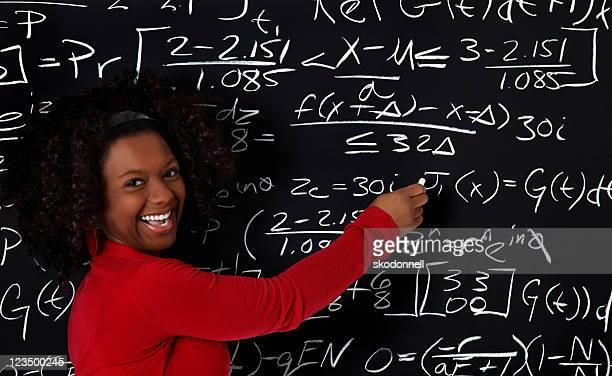 Student Writing on a Blackboard