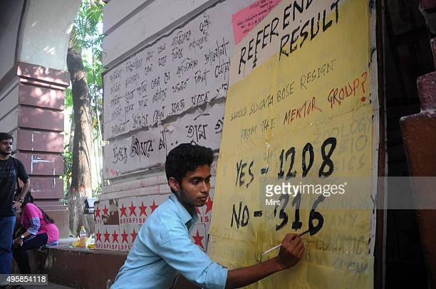 Student writing on board showing the result of referendum by students of Presidency University on seeking the removal from its governing council a...