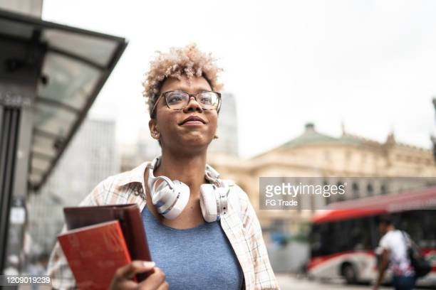 student young woman walking in the city - college student stock pictures, royalty-free photos & images