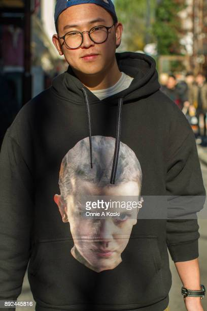 Student Zhang Zhiqi wearing a Stranger Things Eleven sweatshirt stops for a quick fashion snap while visiting Harajuku from China on December 03 2017...