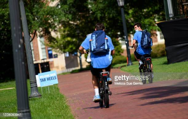 Studentathletes ride through the campus of the University of North Carolina at Chapel Hill on August 18 2020 in Chapel Hill North CarolinaThe school...