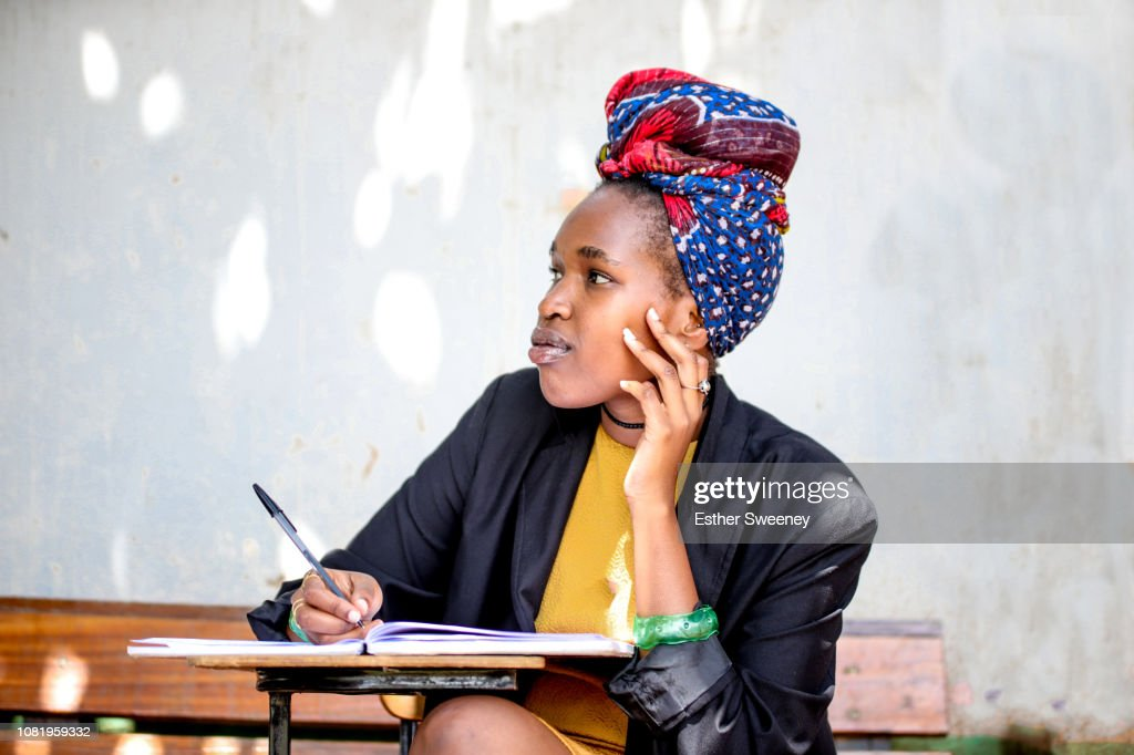 Young woman in deep thought : Stock Photo