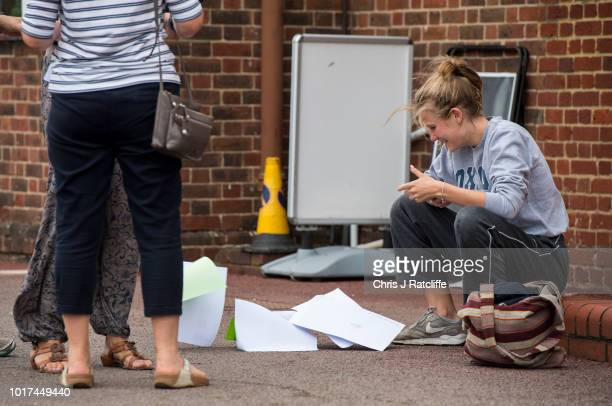 A student's A level results papers blow on the ground after opening them at Lady Eleanor Holles school on August 16 2018 in Hampton United Kingdom A...