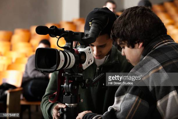 students adjusting video camera equipment - television camera stock pictures, royalty-free photos & images