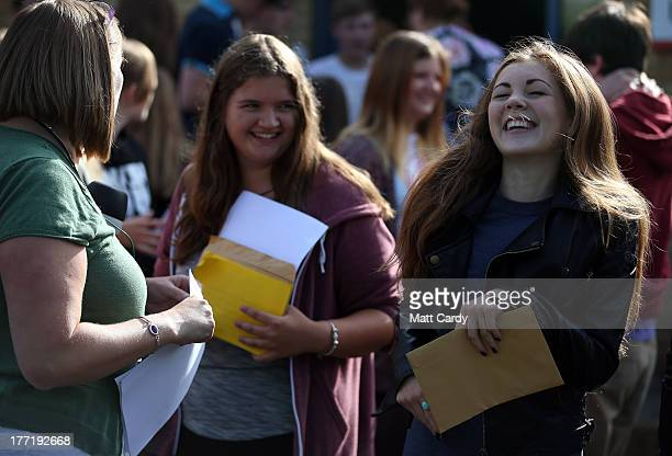 Students Amelia Church and Hannah Clark open their GCSE results outside the Ridings' Federation Winterbourne International Academy on August 22 2013...