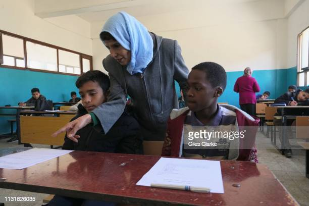 Students and a teacher in a public school classroom on February 3, 2019 in Benghazi, Libya. About 1,500 children attend the school . The children are...
