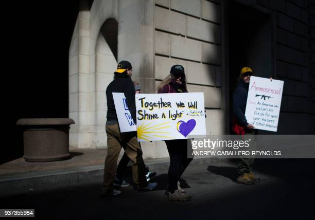 TOPSHOT Students and activists display posters and chant slogans during the March For Our Lives rally against gun violence in Washington DC on March...