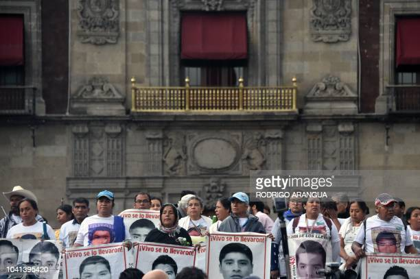 Students and activists take part in a demonstration to mark the fourth anniversary of the disappearance of 43 students of the teaching training...