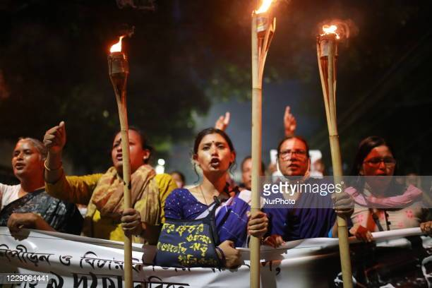 Students and activists take part in a torchlit march during an ongoing protest against an alleged gangrape and brutally torturing of a woman in the...