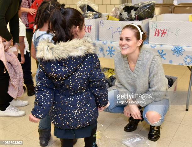 Students and Alexandria DeVillers participate in the HM And Children's Health Fund Celebrate Giving Tuesday at PS 36 The Margaret Douglas School on...