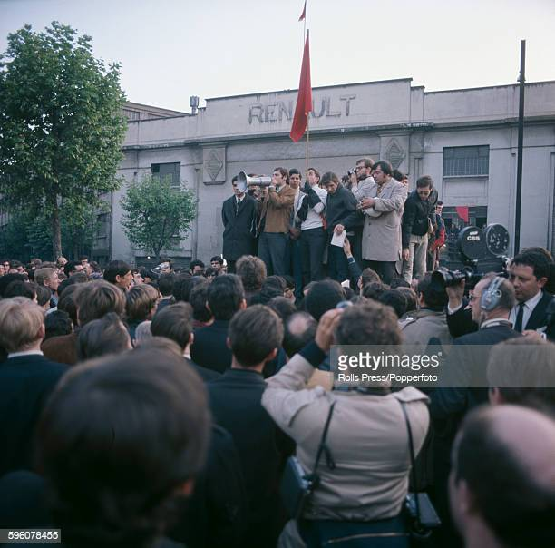 Students and car workers protest outside the Renault car factory in BoulogneBillancourt district of Paris during a nationwide general strike by...