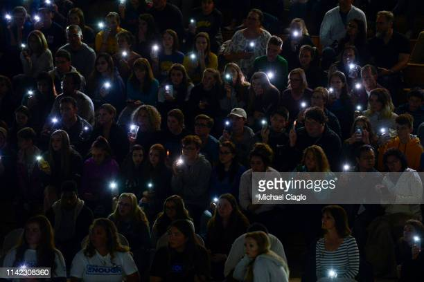 Students and community members hold up their phones during a candlelight vigil at Highlands Ranch High School on May 8 2019 in Highlands Ranch...