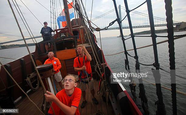 Students and crew members work on the Half Moon a replica of the ship Henry Hudson sailed when he discovered Manhattan in front of the...