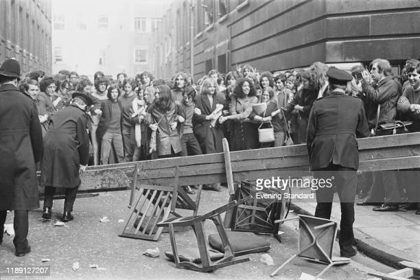 Students and demonstrators clash with Metropolitan police officers clearing a makeshift barricade outside the London School of Economics in Houghton...