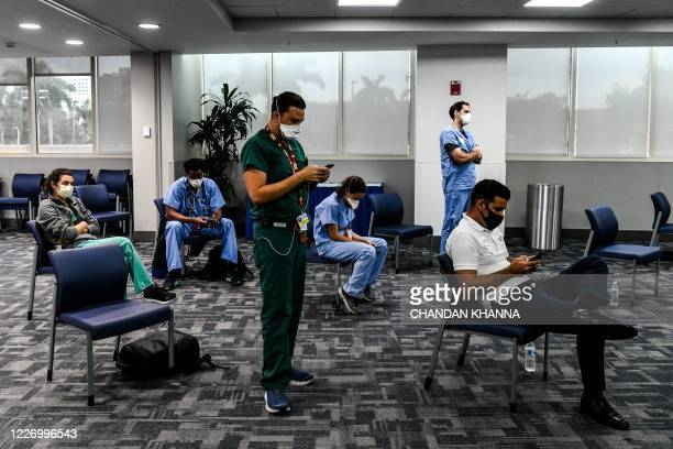 Students and doctors of Medical Science listen to the governor of Florida during a press conference to address the rise of coronavirus cases in the...