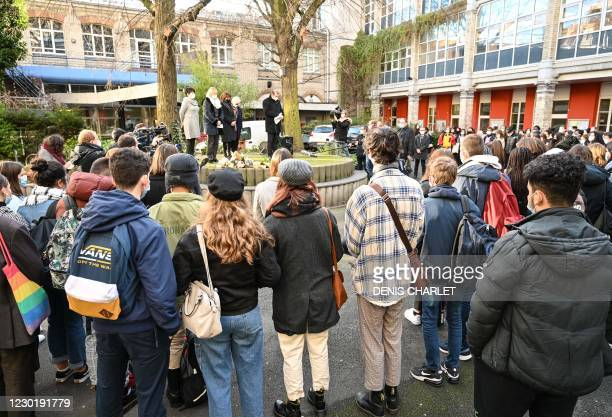 Students and educational staff gather in the schoolyard of Lycee Fenelon in Lille on December 18, 2020 to pay tribute to a transgender student two...