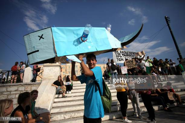 Students and environmental organisations hold placards during a rally in front of the Greek Parliament for the movement Fridays for Future against...