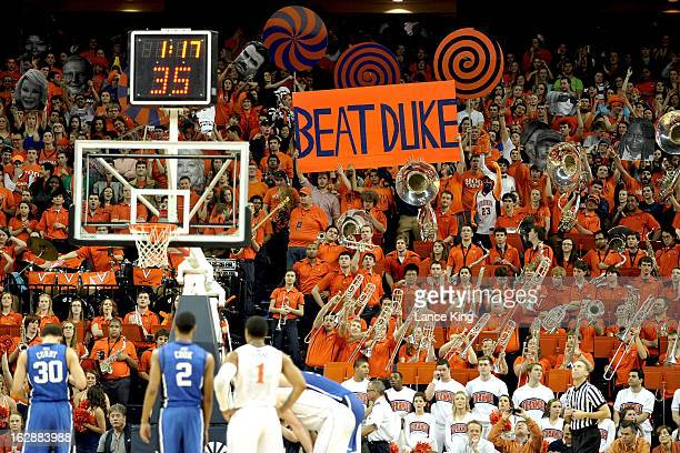 Students and fans of the Virginia Cavaliers try to distract Seth Curry of the Duke Blue Devils during a free throw attempt at John Paul Jones Arena...