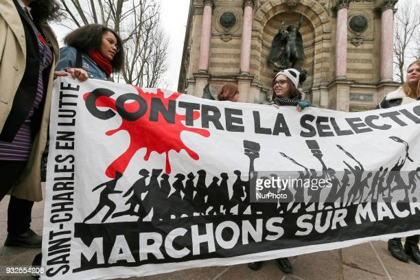 Students and high school students hold a banner reading quotAgainst the selection let us walk against Macron » as they take part in a rally to...