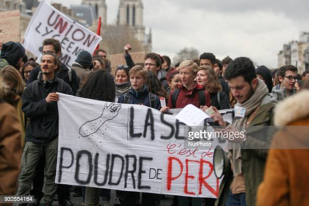 Students and high school students march a long the Seine River behind a banner reading quotThe selection its pixie dust » as they take part in a...