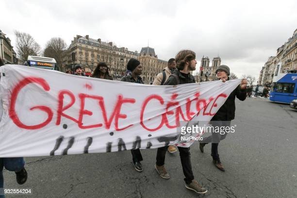Students and high school students march behind a banner reading quot Unlimited general strike quot as they take part in a rally to protest against a...