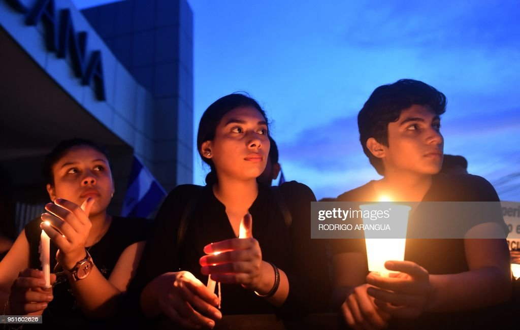 Students and journalist protest in memory of murdered journalits Angel Gaona in front of the Universidad Centroamericana (UCA) in Managua on April 26, 2018. - Nicaragua on Thursday was hanging on to the prospect of talks to calm anti-government sentiment behind a week of protests in which at least 37 people died, according to rights groups.