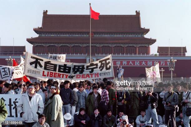 Students and local people gathered at Tiananmen Square in Beijing on May 14, 1989 after an over-night hunger strike as part of the mass pro-democracy...