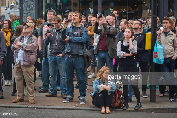 Students and members of the public react as a fire engulfs the Glasgow School of Art Charles Rennie Mackintosh Building on May 23 2014 in Glasgow...