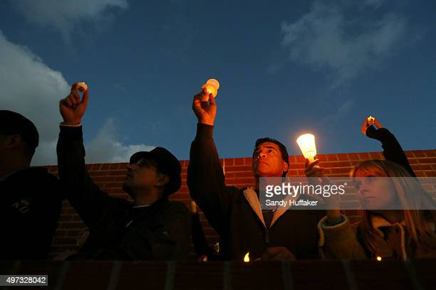 Students and mourners hold candles to honor Nohemi Gonzalez who was killed during the attacks in Paris on November 15 2015 in Long Beach California...