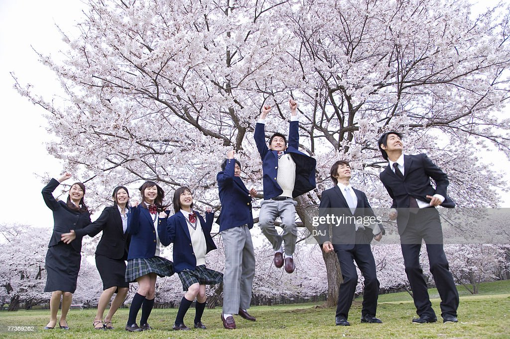 Students and New Business People Jumping,  Side View, Low Angle View, Full Length : Photo