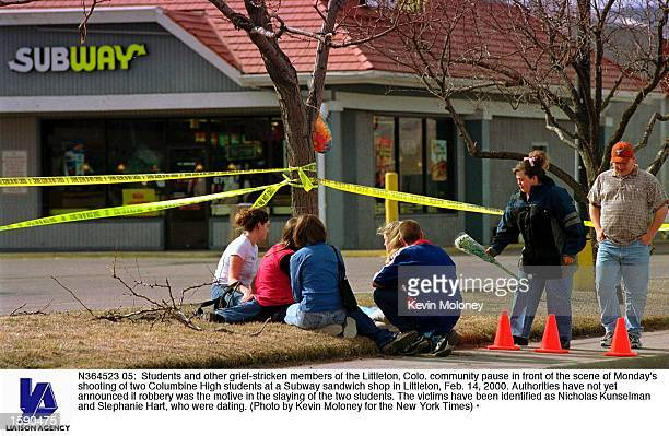 Students and other griefstricken members of the Littleton Colo community pause in front of the scene of Monday's shooting of two Columbine High...