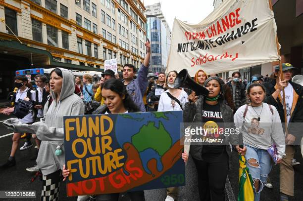 Students and other protesters hold placards during a climate protest organised by School Strike 4 Climate Australia in Sydney, Australia, on May 21,...