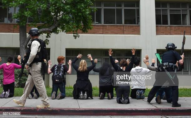Students and others are searched by security officers after a campus shooting June 1 2016 at the University of California's Los Angeles campus in Los...