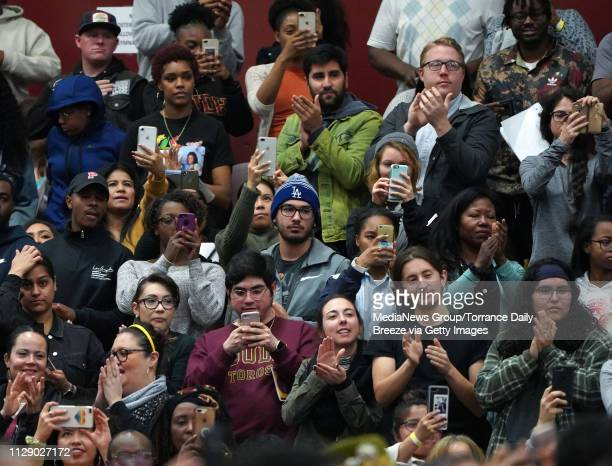 Students and others stand to applaud and photograph Dr Angela Davis as she speaks in the packed gymnasium at CSU Dominguez Hills in Carson on Monday...