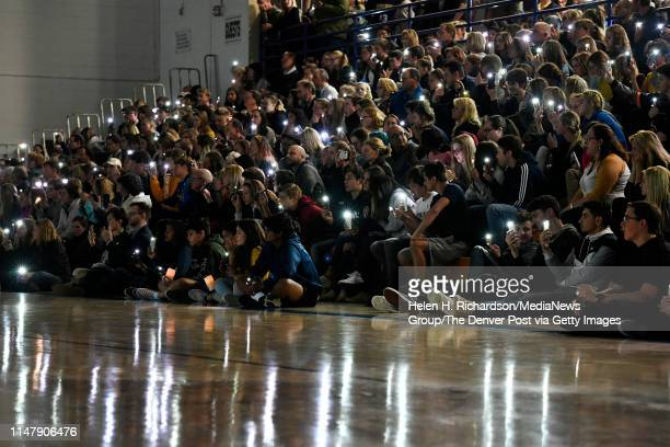 Students and parents hold up phone lights during a vigil for Kendrick Castillo in the gymnasium at Highlands Ranch High School on May 8, 2019 in...