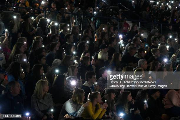 Students and parents hold up phone lights during a vigil for Kendrick Castillo in the gymnasium at Highlands Ranch High School on May 8 2019 in...