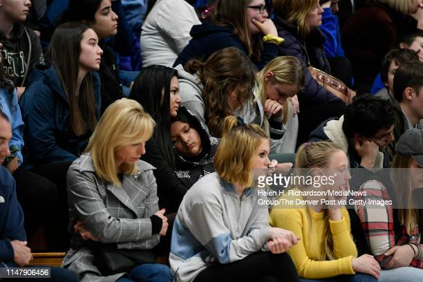 Students and parents hug during a vigil in the gymnasium for Kendrick Castillo at Highlands Ranch High School on May 8 2019 in Highlands Ranch...