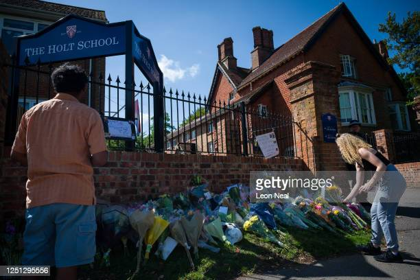 Students and parents lay flowers and pay their respects to the murdered school teacher James Furlong outside The Holt School on June 22 2020 in...