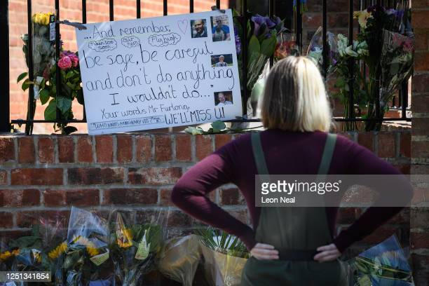 Students and parents lay flowers and pay their respects to the murdered school teacher James Furlong outside The Holt School, on June 22, 2020 in...