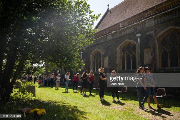 Students and parents queue to enter St Paul's church as they pay their respects to the murdered school teacher James Furlong near The Holt School on...