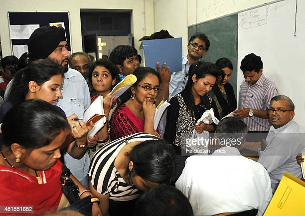 Students and parents wait to submit fees at Ramjas college after the first cut off list came out for admission at Delhi University on July 1 2014 in...