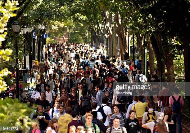 Students and pedestrians fill Locust Walk on the University of Pennsylvania campus in Philadelphia, Pennsylvania, Tuesday, October 3, 2006.