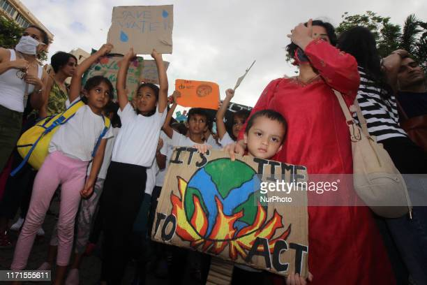 Students and people hold placards as they participate in a protest against climate change in Mumbai India on 27 September 2019 As they have joined a...