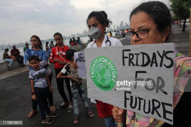 Students and people hold placards as they participate in a protest against climate change in Mumbai India on 01 November 2019 As they have joined a...