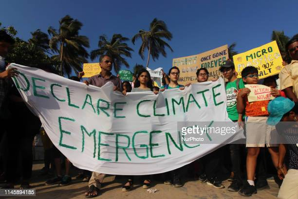 Students and people hold placards as they participate in a rally against climate change in Mumbai India on 24 May 2019 As they have joined a global...