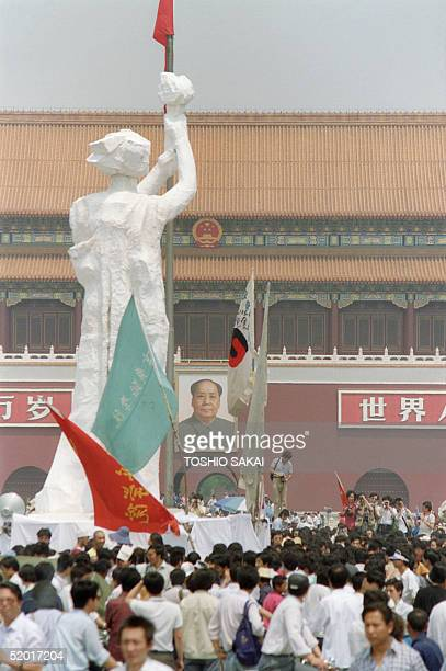 """Students and people of Beijing gather 30 May 1989 in Tiananmen Square to discover a """"Statue of Liberty"""", a replica of New York Statue of Liberty..."""