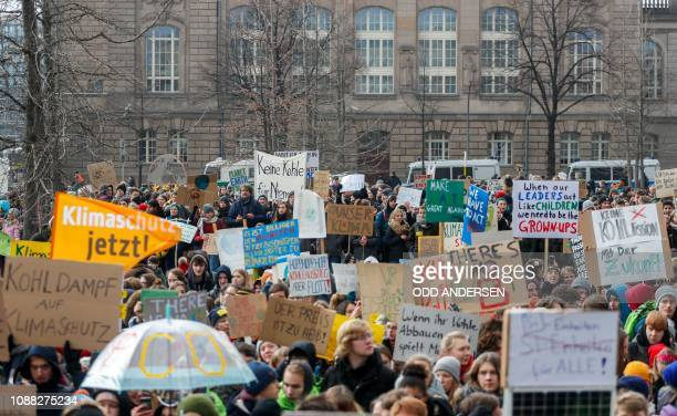 Students and pupils demonstrate as part of the Fridays for Future protest with banners and placards calling for climate protection on January 25 2019...